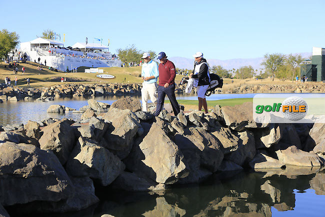 Bill Haas and Phil Mickelson (USA) walk off the 17th island green during Saturday's Round 3 of the 2017 CareerBuilder Challenge held at PGA West, La Quinta, Palm Springs, California, USA.<br /> 21st January 2017.<br /> Picture: Eoin Clarke | Golffile<br /> <br /> <br /> All photos usage must carry mandatory copyright credit (&copy; Golffile | Eoin Clarke)