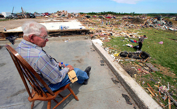 """There ain't nothing here in this house,"" said Walt Truitt as he sits on a bare slab that used to be the house of his duagther, Paula Buchholz Monday, May 26, 2008 in Parkersburg, Iowa. ""It didn't take two minutes to wipe it all away;"" he said of Sunday night's EF-5 tornado.  Truitt survived the tornado with his family in the house's basement."