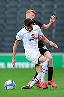 Lincoln City's Callum Morton vies for possession with Milton Keynes Dons' Regan Poole<br /> <br /> Photographer Chris Vaughan/CameraSport<br /> <br /> The EFL Sky Bet League One - Milton Keynes Dons v Lincoln City - Saturday 19th September 2020 - Stadium MK - Milton Keynes<br /> <br /> World Copyright © 2020 CameraSport. All rights reserved. 43 Linden Ave. Countesthorpe. Leicester. England. LE8 5PG - Tel: +44 (0) 116 277 4147 - admin@camerasport.com - www.camerasport.com
