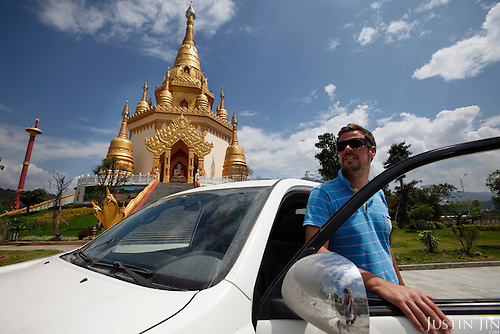 Christoph Albrecht visits a pagoda on the road in Yunnan province.