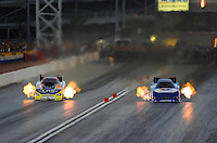 Nov. 1, 2008; Las Vegas, NV, USA: NHRA funny car driver Tim Wilkerson (left) races alongside Jack Beckman during qualifying for the Las Vegas Nationals at The Strip in Las Vegas. Mandatory Credit: Mark J. Rebilas-