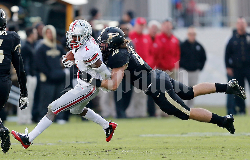 Ohio State Buckeyes running back Dontre Wilson (1) tries to get away from Purdue Boilermakers linebacker Sean Robinson (10) during the first half of the NCAA football game at Ross-Ade Stadium in West Lafayette, IN on Saturday, November 2, 2013. (Columbus Dispatch photo by Jonathan Quilter)
