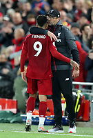 27th October 2019; Anfield, Liverpool, Merseyside, England; English Premier League Football, Liverpool versus Tottenham Hotspur; Liverpool manager Jurgen Klopp hugs Roberto Firmino of Liverpool as he is substituted off during the second half  - Strictly Editorial Use Only. No use with unauthorized audio, video, data, fixture lists, club/league logos or 'live' services. Online in-match use limited to 120 images, no video emulation. No use in betting, games or single club/league/player publications