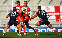 PICTURE BY VAUGHN RIDLEY/SWPIX.COM...Rugby League - International Friendly - England Knights v France - Leigh Sports Village, Leigh, England - 15/10/11…England's Lee Mossop is tackled by France's Kane Bentley and Jamal Fakir.