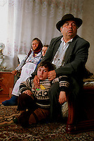Marin Grinea Stoica, bulibasha, leader of the gypsies, with his grandson, in Buzescu village, Romania.April 2000.©Karen Robinson