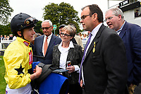 Jockey Finlay Marsh talks to connections of Beringer in the winners enclosure during Ladies Evening Racing at Salisbury Racecourse on 15th July 2017