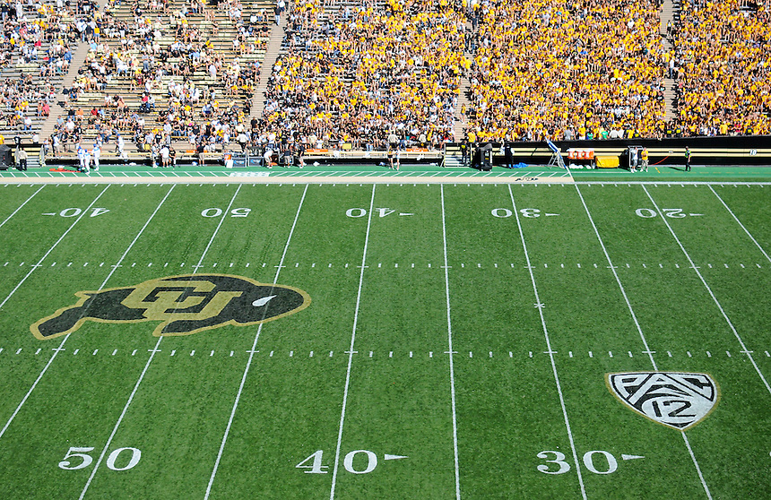 SEPTEMBER 10 2011:  The PAC 12 logo and the CU logo are freshly painted on the field during the first game of the year as student fans fill the student section wearing school colors  during a non-conference game with two PAC 12 teams between the Californa Golden Bears and the University of Colorado Buffaloes at Folsom Field in Boulder, Colorado. The Golden Bears beat the Buffaloes 36-33 in overtime.  *****For editorial use only*****