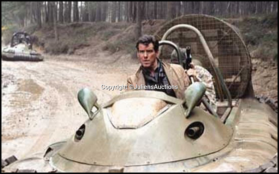 BNPS.co.uk (01202 558833)<br /> Pic: JuliensAuctions/BNPS<br /> <br /> ***Please Use Full Byline***<br /> <br /> Pierce Brosnan as James Bond 007 in the film Die Another Day.<br /> <br /> Est: £30,000<br /> <br /> The iconic micro-jet flown by Roger Moore in Octopussy and the swivel chair used by super-villain Blofeld are among a host of props from James Bond movies coming up for sale.<br /> <br /> The 12ft long BD-5J red, white and blue aircraft, that is the world's lightest jet, was piloted by 007 in the opening scenes of Octopussy, outwitting his Cuban captors.<br /> <br /> The aircraft was actually built seven years before the film as part of an air display team and was hired for the 1983 Bond flick.