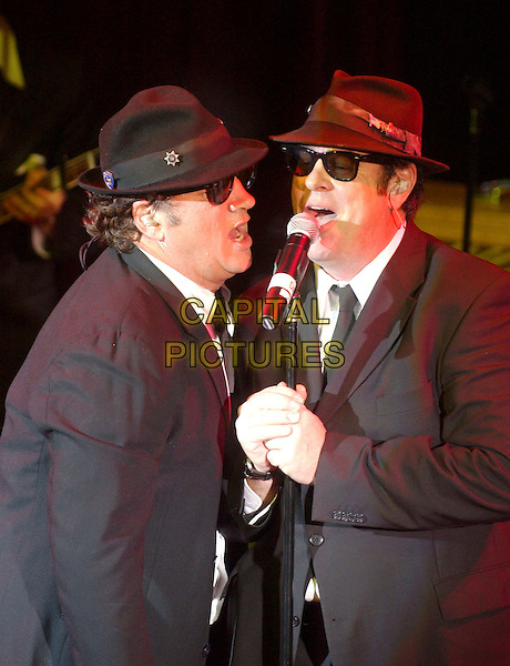 JIM BELUSHI & DAN AYKROYD.feature in The Blues Brothers Revue during the grand opening celebration at the Cleveland House of Blues Club, Cleveland, Ohio, USA, .28th November 2004  .half length show stage concert costume.Ref: ADM.www.capitalpictures.com.sales@capitalpictures.com.©Laura Farr/AdMedia/Capital Pictures .