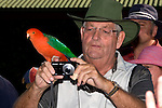 Photographing an Australian King Parrot , Bunya Mts, Queensland, Australia.   //   Australian King Parrot - Psittacidae: Alisterus scapularis. Length to 43cm, wingspan to XXcm, weight to 210g. Found in tropical and temperate rain forests, woodland and suburban areas  on the east coast of Australia from Cooktown in Queensland, to Otway Range in Victoria. Immature birds have plumage similar to the female - green head and neck, remainder duller than male. Solitary or in small groups. IUCN Conservation Status: Least Concern.  / Bunya Mountains National Park was declared Queensland's second National Park in 1908 - an outlier of the Great Dividing Range rising to 1100m (3500 feet), some 200km (3 hours drive) north-west of Brisbane, with plentiful accommodation in bungalows and chalets.  Cool in winter (mid-year), pleasant in summer (Christmas period), with abundant wildlife, plants and scenery appealing especially to naturalists and photographers. The peaks are covered in damp rainforests, with unique range-top grasslands known as 'Balds'and waterfalls through the forests. The world's largest stand of Bunya Pines Araucaria bidwilli (also known as False Monkey Puzzle Tree) occurs here. Habitats include wet mesophyll forest, sub-tropical rainforest, vine-thickets, dry sclerophyll eucalyptus forest, and high grasslands. 11700Ha (26000 acres) in area, with wildlife highlights including the Black-breasted Button-quail, Green Catbirds, Paradise Riflebirds (one of Australia's three Birds of Paradise), plentiful Rufous-necked Wallabies, and Great Barred Frogs.   /   Bunya Pine - Araucariaceae: Araucaria bidwilli. Height to 35m, DBH to 3m, age to 500years. Relict populations and individual trees occur throughout sub-tropical Qld.  //  Dr Eric Lindgren  //