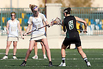 Santa Barbara, CA 02/13/10 - Lacey Vatland (Lindenwood # 18) and Sarina Madnick (Cal Poly #9) in action during the Lindenwood-Cal Poly SLO game at the 2010 Santa Barbara Shoutout, Lindenwood defeated Cal Poly SLO 7-6.