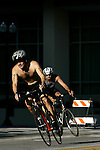 Saturday, September 13, 2008, during the OUC Downtown Orlando Triathlon in Downtown Orlando. The triathlon which is made up of three diciplines was a 1/4 mile swim, a 11.7 mile bike and a 3.9 mile run. According to their website at www.downtownorlandotriathlon.com, this is one of America?s only urban triathlons. The swim was at Lake Underhill and the bike and run weaved through Downtown Orlando to a finish at Wall Street Plaza. Chuck Price <cq>, 33 and from College Park in Orlando, won with a time of 1:01:25 as he sprinted past Mike Easterling <cq>, 38 from Orlando, who followed by 3 seconds. Nic Tautiva <cq>, from Clermont, had the fastest time of 58:59, but was disqualified for taking an incomplete course. (Chad Pilster, pilsterphotography.com for the Orlando Sentinel)