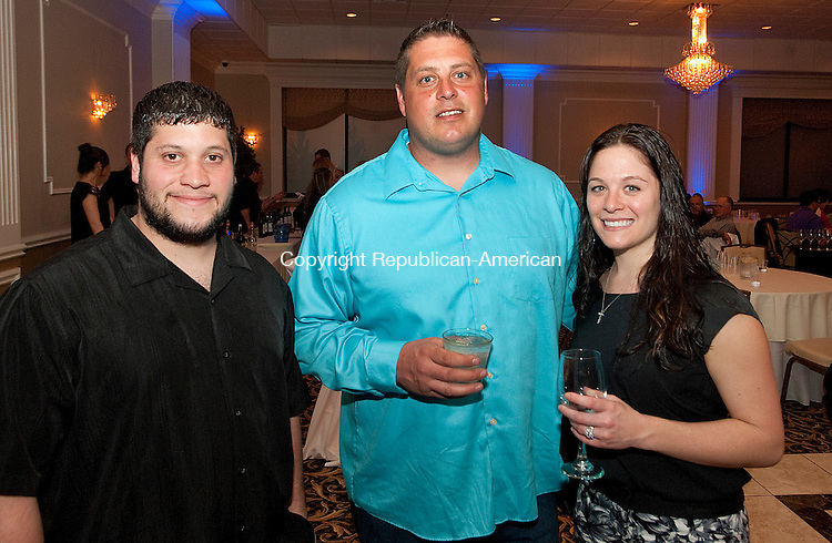 WATERBURY, CT-041114JS13- John Riggi of Prospect; Scott Simpson of Waterbury and Michelle Riggi of Prospect at the Seventh Annual &quot;Wishes from Waterbury&quot; wine and beer tasting fundraiser to benefit the Make-A-Wish Foundation of Connecticut. The event was held at La Bella Vista at the Ponte Club in Waterbury. <br /> Jim Shannon Republican-American