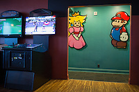 Princess Toadstool and Mario mark the respective bathrooms at Boxcar Bar and Arcade in Raleigh, North Carolina on Thursday, January 22, 2015. (Justin Cook)