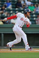 Second baseman Yoan Moncada (24) of the Greenville Drive bats in a game against the Greensboro Grasshoppers on Thursday, August 27, 2015, at Fluor Field at the West End in Greenville, South Carolina. The Cuban-born 19-year-old Red Sox signee has been ranked the No. 1 international prospect in baseball by Baseball America. Greenville won, 10-2. (Tom Priddy/Four Seam Images)