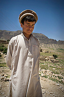 A boy wearing a Pakul hat.