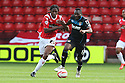 Francis Zoko of Stevenage battles with Romaine Sawyers of Walsall<br />  - Walsall v Stevenage - Sky Bet League One - Banks's Stadium, Walsall - 19th October 2013. <br /> © Kevin Coleman 2013