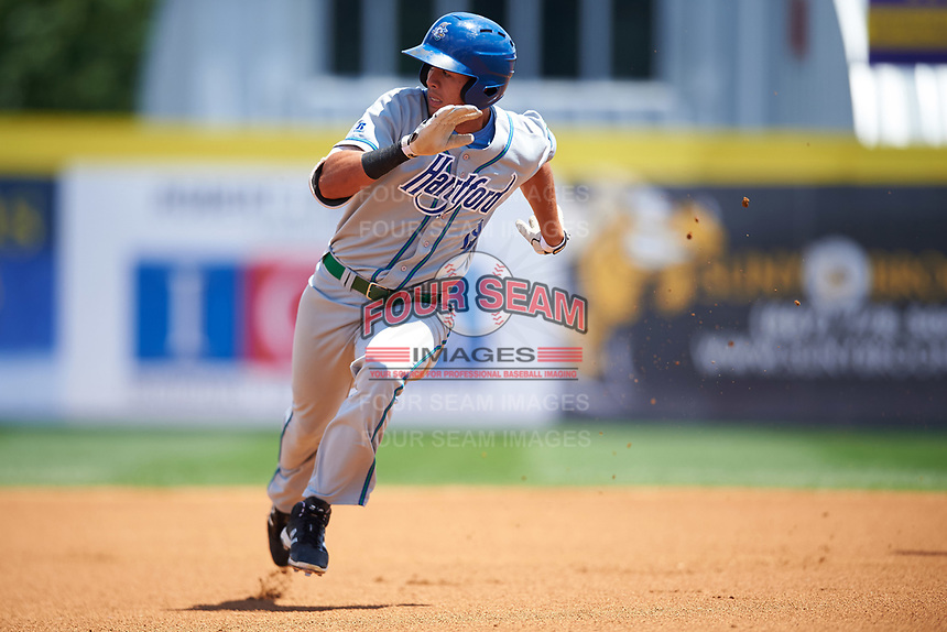 Hartford Yard Goats center fielder Omar Carrizales (19) running the bases during a game against the Binghamton Rumble Ponies on July 9, 2017 at NYSEG Stadium in Binghamton, New York.  Hartford defeated Binghamton 7-3.  (Mike Janes/Four Seam Images)