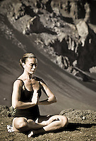 Woman in meditation posture at Haleakala crater, Island of Maui