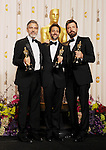 HOLLYWOOD, CA - FEBRUARY 24: George Clooney, Grant Heslov and Ben Affleck pose in the press room the 85th Annual Academy Awards at Dolby Theatre on February 24, 2013 in Hollywood, California.