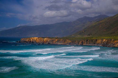 Waves pound upon the shoreline along California's Pacific Ocean Coastline at Sand Dollar Beach near Big Sur.