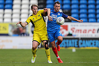 Christian Ribeiro of Oxford United and Ricky Miller of Peterborough United during the Sky Bet League 1 match between Peterborough and Oxford United at the ABAX Stadium, London Road, Peterborough, England on 30 September 2017. Photo by David Horn.