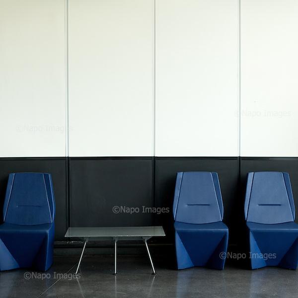 STRASBOURG, FRANCE, NOVEMBER 28, 2014: Chairs and table in empty parliament building a day after the plenary session. Every month thousands of parliament's employees travel back and forth between the towns, with their documents and other useful stuff following them. Strasbourg venue is empty between the sessions.<br /> (Photo by Piotr Malecki / Napo Images)  <br /> STRASBURG, FRANCJA, 28/11/2014: Fotele i stol w kawiarni w pustym parlamencie jeden dzien po zakonczeniu sie sesji parlamentarnej. Kazdego miesiaca tysiace pracownikow parlamentu podrozuje miedzy siedzibami w Brukseli, Strasburgu i Luksemburgu, za nimi podrozuja ich dokumenty i inne potrzebne rzeczy. Budynek stoi pusty miedzy sesjami.<br /> Fot: Piotr Malecki / Napo Images