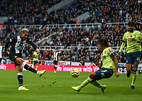 9th November 2019; St James Park, Newcastle, Tyne and Wear, England; English Premier League Football, Newcastle United versus AFC Bournemouth; Joelinton of Newcastle United shoots for goal past Nathan Ake of AFC Bournemouth but it  was saved - Strictly Editorial Use Only. No use with unauthorized audio, video, data, fixture lists, club/league logos or 'live' services. Online in-match use limited to 120 images, no video emulation. No use in betting, games or single club/league/player publications
