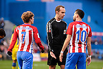 Atletico de Madrid Antoine Griezmann and Yannick Carrasco talking with the referee during La Liga match between Atletico de Madrid and UD Las Palmas at Vicente Calderon Stadium in Madrid, Spain. December 17, 2016. (ALTERPHOTOS/BorjaB.Hojas)