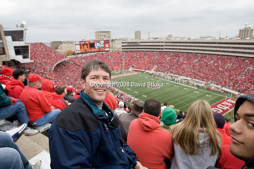 MADISON, WI - OCTOBER 25: Photographer David Stluka poses for a photo at the top of Camp Randall Stadium during the Wisconsin Badgers game against the Illinois Fighting Illini at Camp Randall Stadium on October 25, 2008 in Madison, Wisconsin. The Badgers beat the Fighting Illini 27-17. (Photo by David Stluka)