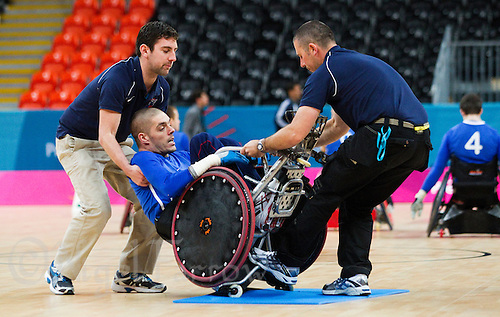 18 APR 2012 - LONDON, GBR - Tim Ryan (left) and Iain McLellen (on right) right Great Britain's Mike Kerr (GBR) (centre) during the London International Invitational Wheelchair Rugby Tournament match against Sweden at the Olympic Park Basketball Arena in Stratford, London, Great Britain (PHOTO (C) 2012 NIGEL FARROW)