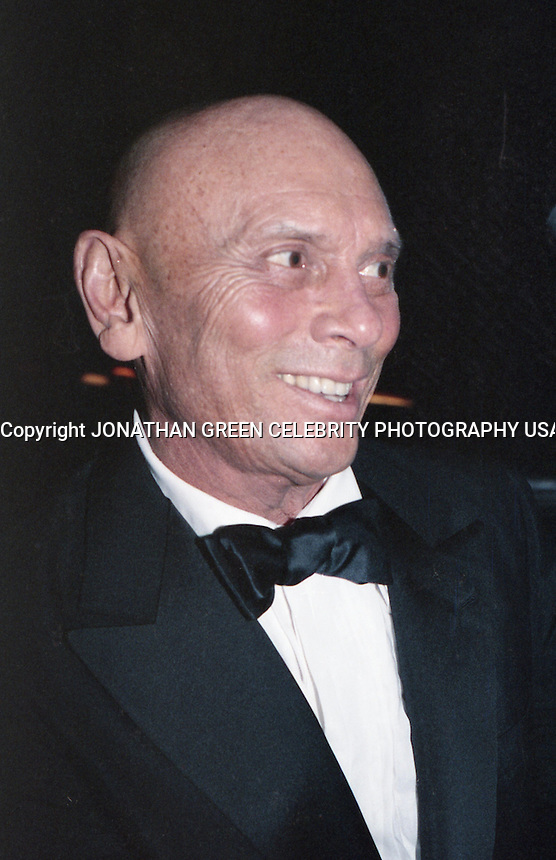 Yul Brynner attending Tony Awards party in<br /> NYC early 1980's