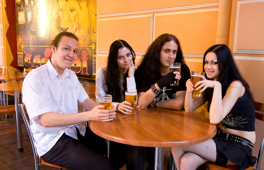 The Gothic life of teenagers having beer at restaurant in black dress in Kiev Ukraine as alternative lifestyle
