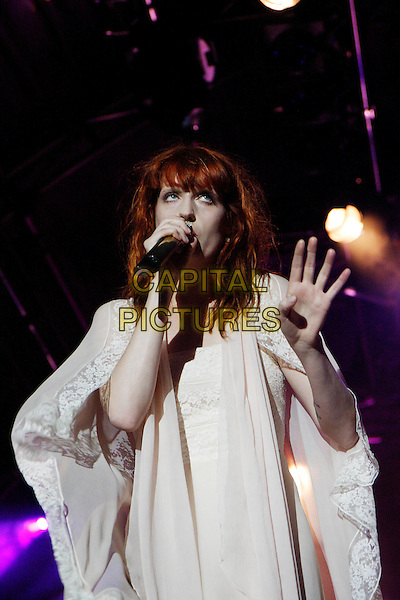 FLORENCE WELCH.Florence and The Machine perform live at Somerset House, London, England..July 15th, 2010.stage concert live gig performance music half length white dress singing hand.CAP/MAR.© Martin Harris/Capital Pictures.