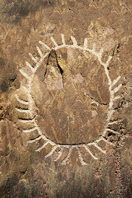 """Prehistoric  petroglyphs, rock carvings, of a sun design carved by the the prehistoric Camuni people in the Copper Age around the 3rd milleneum BC, Stele """"Bagnolo 1"""" found in 1963 from Malegno near Bangnolo Ceresolo. Museo Nazionale della Preistoria della Valle Camonica ( National Museum of Prehistory in Valle Cominca ), Lombardy, Italy. Grey Art Background"""