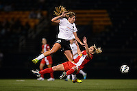 Portland Thorns midfielder Allie Long (10) collides with Western New York Flash midfielder McCall Zerboni (7) while going for a header. The Portland Thorns defeated the Western New York Flash 2-0 during the National Women's Soccer League (NWSL) finals at Sahlen's Stadium in Rochester, NY, on August 31, 2013.