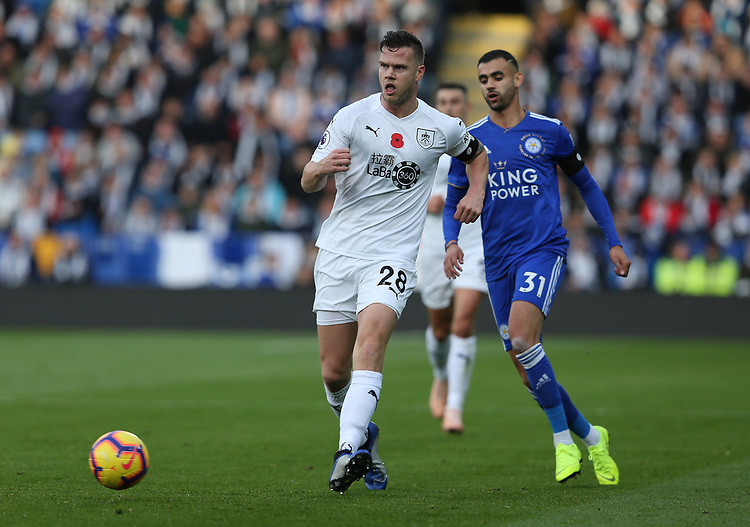 Burnley's Kevin Long shadowed by Leicester City's Rachid Ghezzal<br /> <br /> Photographer Stephen White/CameraSport<br /> <br /> The Premier League - Saturday 10th November 2018 - Leicester City v Burnley - King Power Stadium - Leicester<br /> <br /> World Copyright © 2018 CameraSport. All rights reserved. 43 Linden Ave. Countesthorpe. Leicester. England. LE8 5PG - Tel: +44 (0) 116 277 4147 - admin@camerasport.com - www.camerasport.com