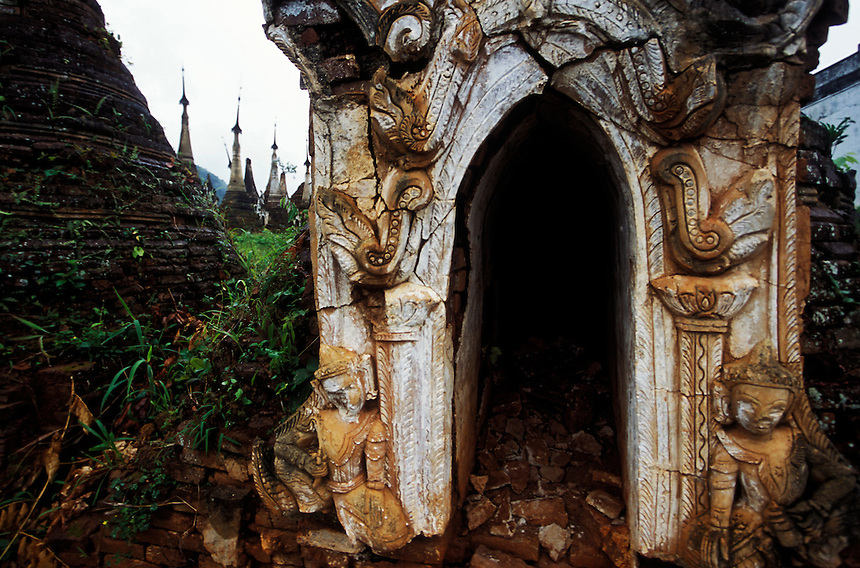 The crumbling remains of a small stupa stand atop a hill studded with hundreds of the same at Indein, Shan State, Burma, 2006.