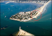 BNPS.co.uk (01202 558833)<br /> Pic: Peter Willows<br /> <br /> Sandbanks peninsula in Poole, Dorset showing the rough location of the house. <br /> <br /> A humble holiday home a family bought for just &pound;1,000 almost a century ago on the exclusive enclave of Sandbanks has turned into a luxury property now worth &pound;5 million.<br /> <br /> The bungalow was bought new by Dr Edward Andreae in the 1920s when the practice of building on the sandy Dorset peninsula was questioned because of perceived issues over stability.<br /> <br /> Over the last seven decades the bolthole has been passed down through the generations of the same family until it fell into a state if disrepair.<br /> <br /> In 2011 Dr Andreae's great-grandson, Tim Baldwin, and his father Jonathan, made the drastic decision to demolish the 90 year old building and erect a new one in its place.<br /> <br /> They spent 580,000 pounds creating a luxurious beach escape on the 'Millionaires' Row' in Poole Harbour.<br /> <br /> The plot is now home to a sprawling seven bedroom, five bathroom property which experts believe to be worth around five million pounds - 5,000 times it's original purchase price.