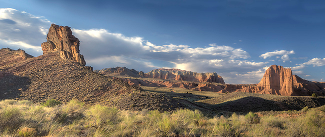 The light from a setting sun casts on Cathedral Valley at Capitol Reef National Park, Utah