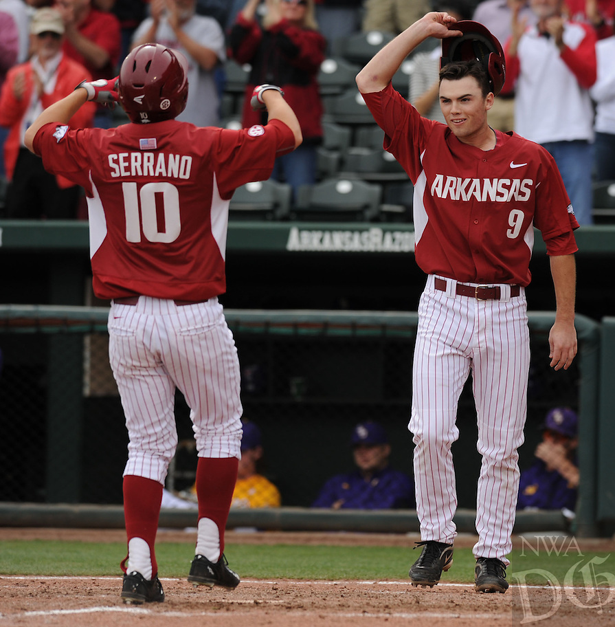 NWA Democrat-Gazette/ANDY SHUPE - Joe Serrano (10) of Arkansas is congratulated at the plate by Clark Eagan after Serrano hit a 2-run home run against LSU during the seventh inning Saturday, March 21, 2015, at Baum Stadium in Fayetteville. Visit nwadg.com/photos for more photos from the game.