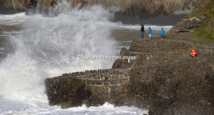 08/04/16 <br /> <br /> A family watches as giant waves crash into at Hartland Quay, North Devon, as strong winds and high tides help to set the dramatic scene.<br /> <br /> All Rights Reserved: F Stop Press Ltd. +44(0)1335 418365   +44 (0)7765 242650 www.fstoppress.com