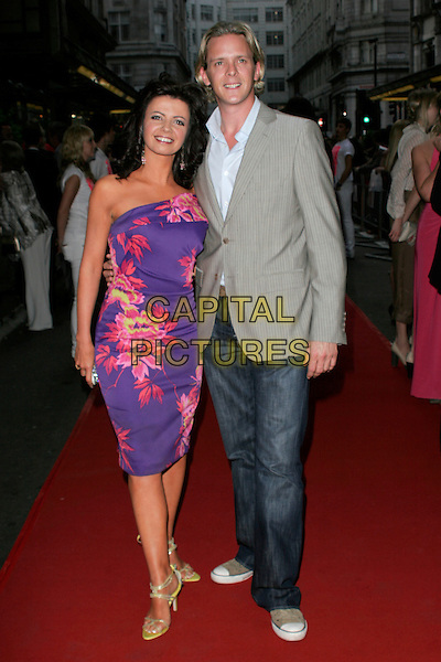 KAREN HARDY & MATHEW CUTLER.The Never Forget Take That Musical - West End Transfer - gala night, Savoy Theatre, London, England. .May 22nd, 2008.full length dress pink purple floral print dress straplessjeans denim grey gray suit jacket.CAP/AH.©Adam Houghton/Capital Pictures.