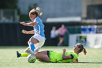 Seattle, WA - Sunday, April 17, 2016: Seattle Reign FC forward Beverly Yanez (17) goes in for a tackle on Sky Blue FC defender Christie Rampone (3) during the second half of the match. Sky Blue FC defeated the Seattle Reign FC 2-1 during a National Women's Soccer League (NWSL) match at Memorial Stadium.