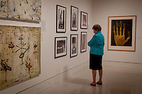 Judy Hushon, The von Liebig Art Center Board, walks through 'Cuba on My Mind' exhibit before ribbon cutting ceremony, March 10, 2011. Photo by Debi Pittman Wilkey