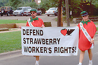 Strawberry worker's activists age 34 marching with banner.  St Paul Minnesota USA