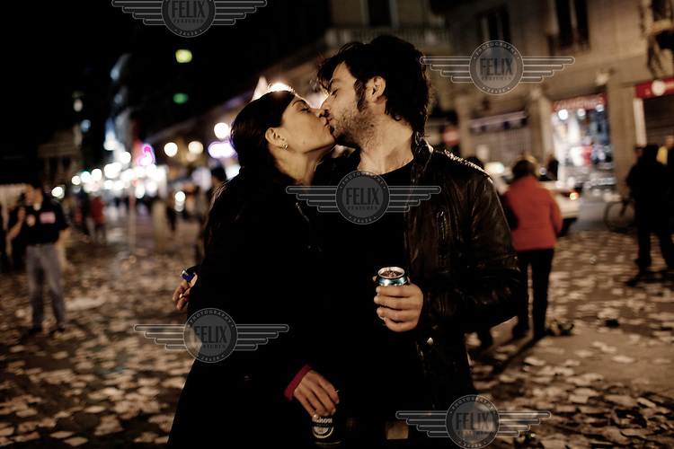 A young couple kiss on the streets of Madrid during the general strike on March 29. The strike was sponsored by the trade union to protest new austerity measures which allow cheaper hirings and dismissals of workers.