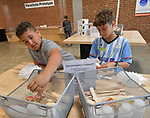 Henry Ladenberger (left) and Alex Faerber, both 10, work on making a small catapult with parts from the bins. The Magic House had two fourth-grade classes from the New City School visit their new permanent satellite location at 5127 Delmar Boulevard in St. Louis, MO on Wednesday May 23, 2019.<br /> Photo by Tim Vizer