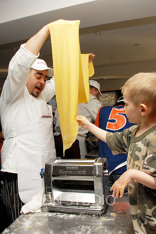 """(L) Chef Paolo Nozzoli. Ciaobella Restaurant brings """"The Art of Pasta"""" to Children In Need. Owner and Chef Enrico Proietti and Executive Chef Floess show the children of the Ronald  McDonald House of NY the history of Italian food."""