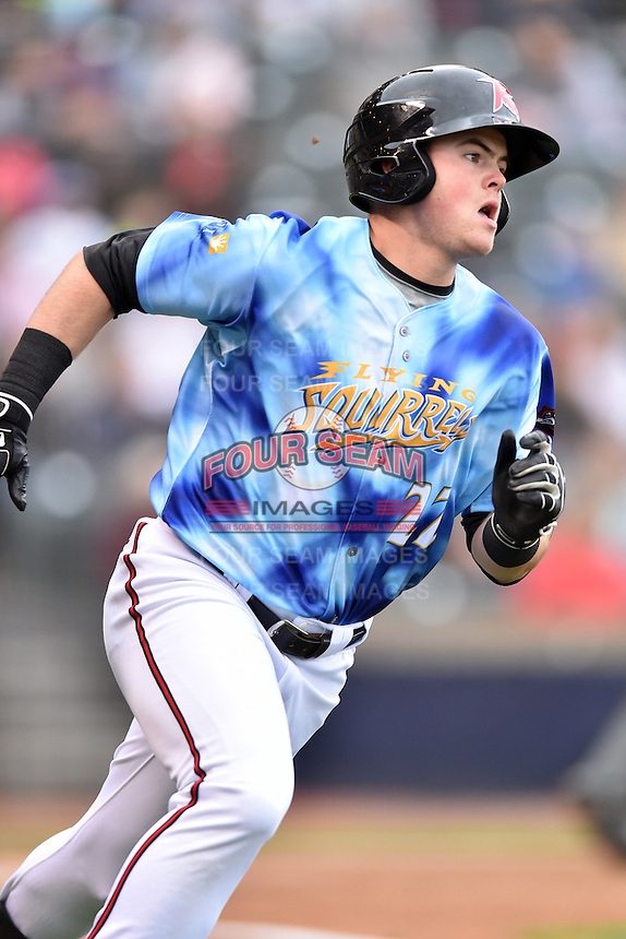 Richmond Flying Squirrels shortstop Christian Arroyo (22) runs to first during a game against the Hartford Yard Goats at The Diamond on April 30, 2016 in Richmond, Virginia. The Yard Goats defeated the Flying Squirrels 5-1. (Tony Farlow/Four Seam Images)